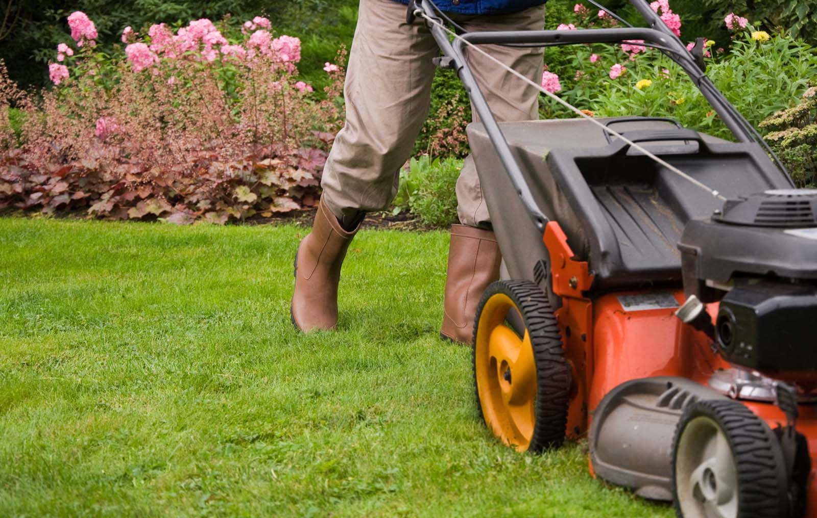 taskforce Mowing lawn in boots